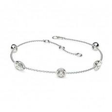 Bracelet délicat diamant rond et poire serti clos