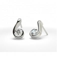 Boucles d'oreilles tendance diamant rond serti  demi-clos en 0.51ct