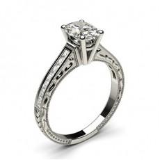 Bague de fiançailles vintage standard épaulée diamant serti 4 griffes rondes et rail
