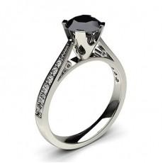 Bague solitaire épaulé large diamant noir serti clos et pavé