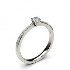 Bague mini épaulée diamant rond serti 4 griffes