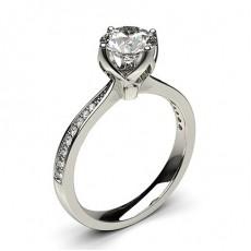 Bague de fiançailles standard solitaire épaulé diamant rond serti 4 griffes rondes et pavé