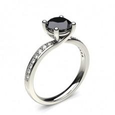 Bague solitaire épaulé diamant noir serti 4 griffes et rail