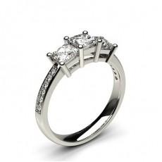 Bague 3 pierres épaulée diamant princesse/rond serti 4 griffes en 0.90ct