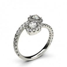 Bague 2 pierres épaulée diamant rond serti 4 griffes
