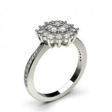 Bague illusion diamant rond serti griffes et pavé en 0.70ct